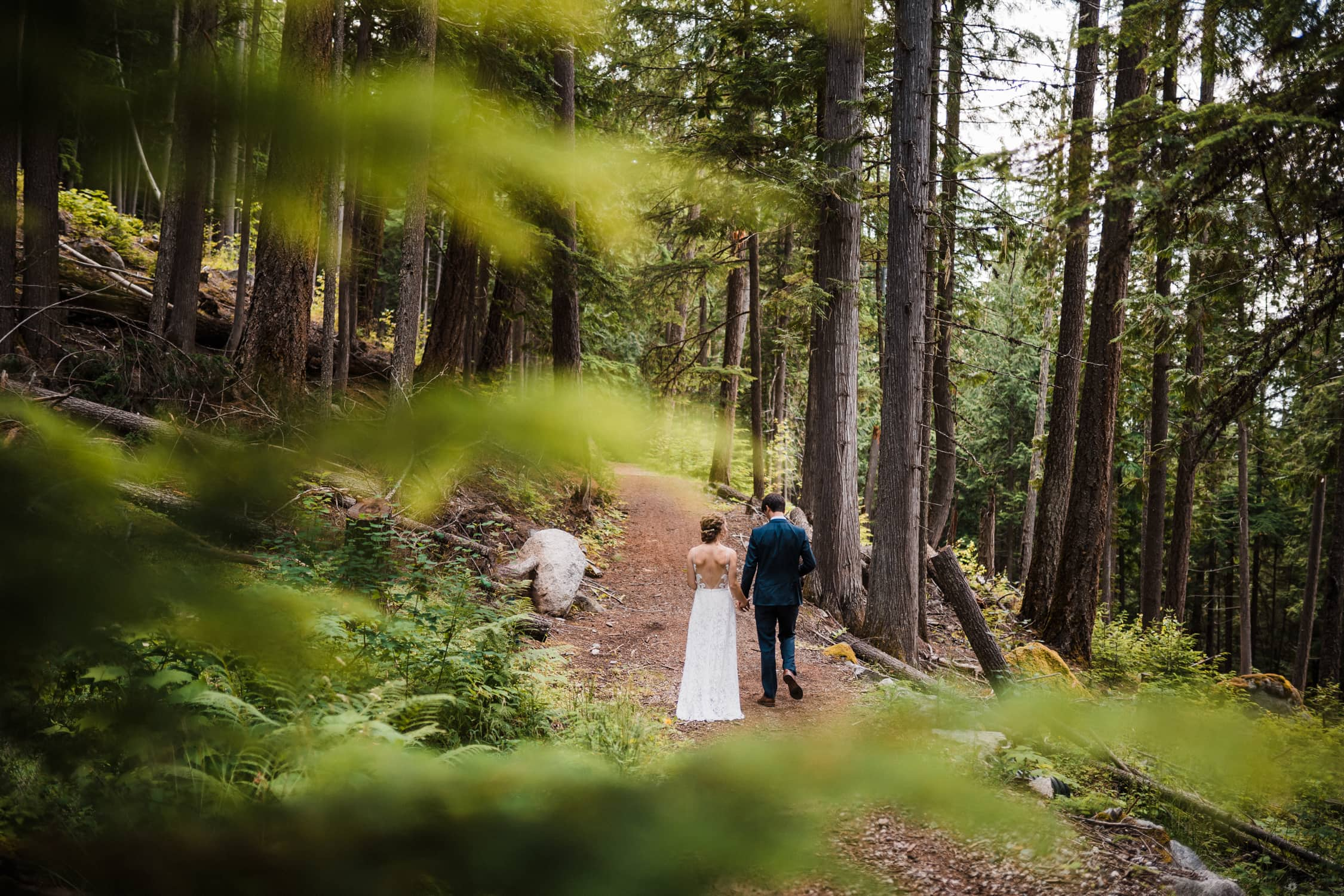 Wedding couple walking in the forest of Nelson, British Columbia