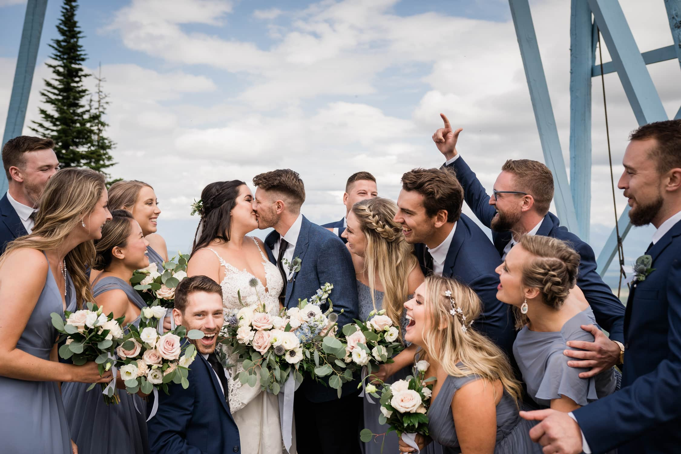 Wedding couple is surrounded by love by their bridal party at the Kimberley Alpine Resort