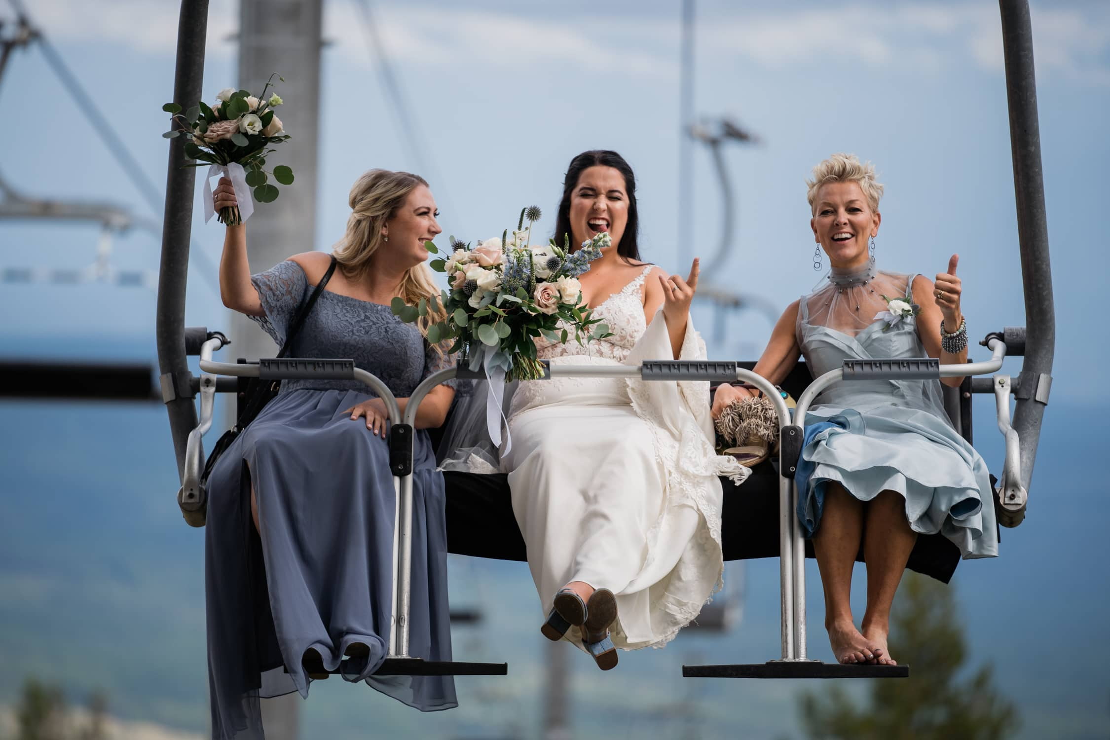 Bride and her Mom and Maid of Honour ride the chair lift to the ceremony at Kimberley Alpine Resort