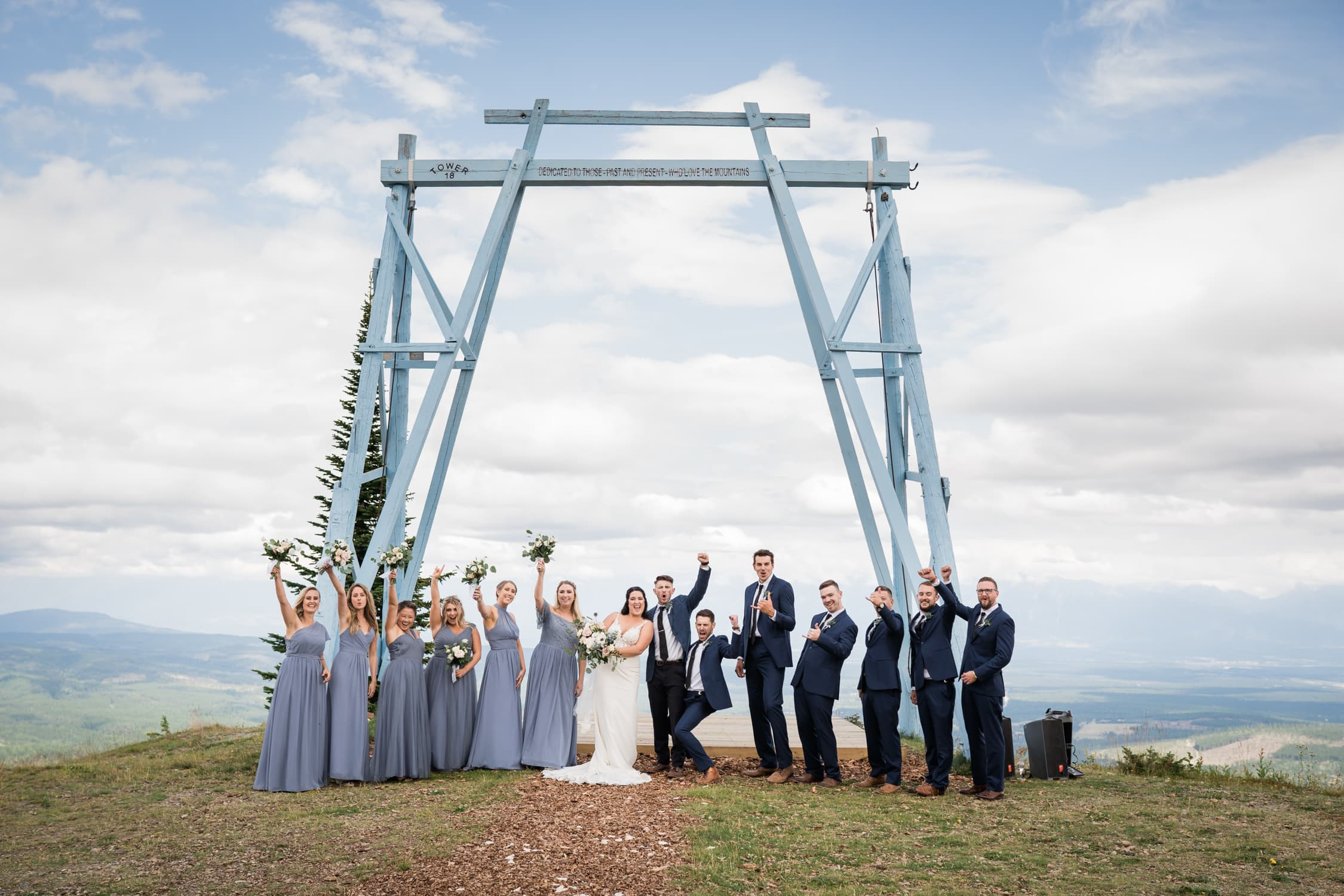 Wedding part celebrates and cheers after the ceremony at Kimberley Alpine Resort