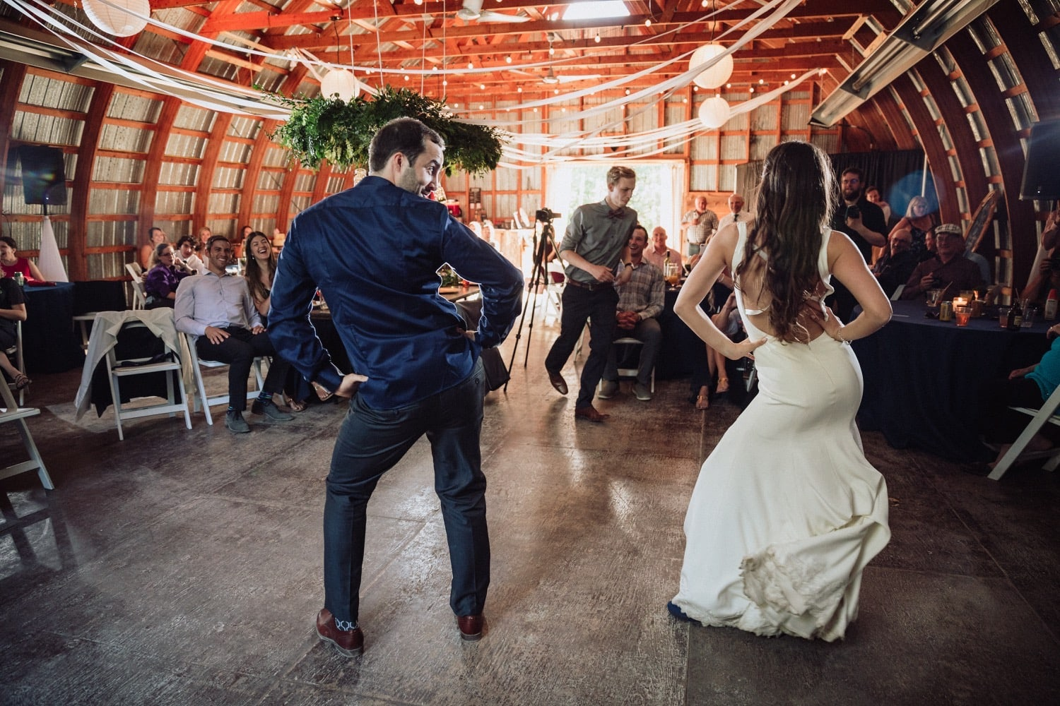 Wedding couple entertains their guests with a fun choreographed first dance at their wedding