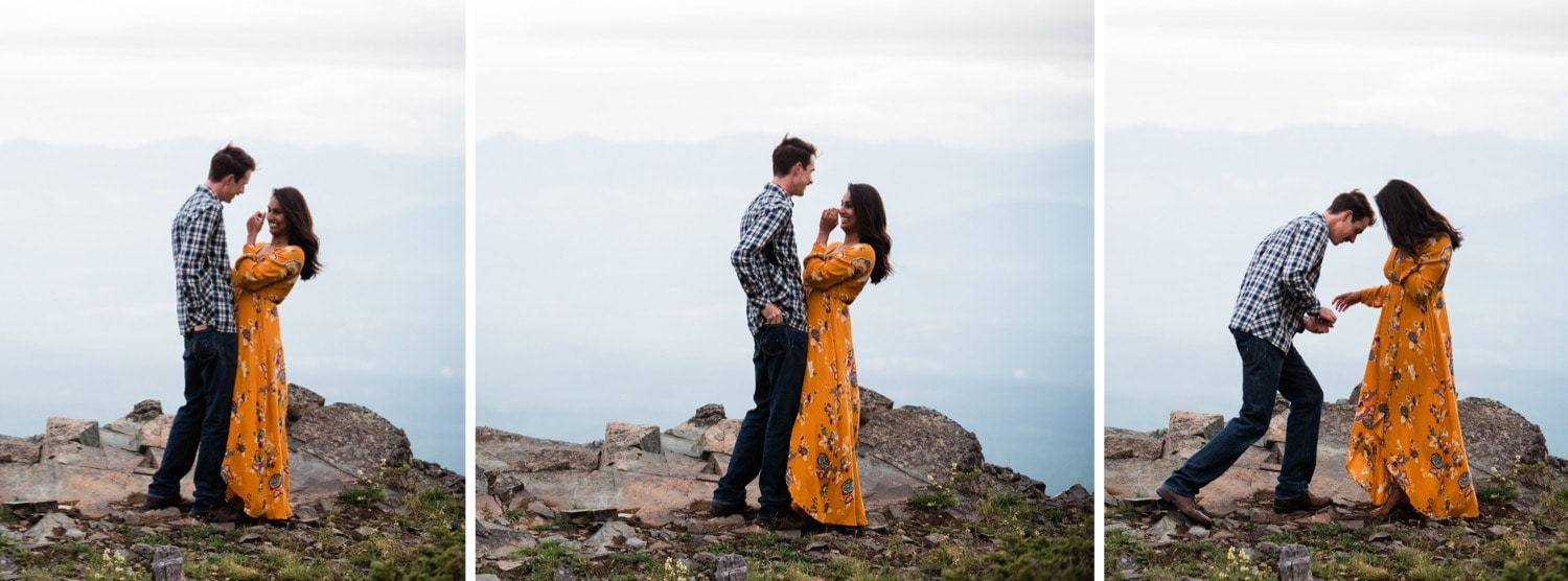 A man pulls a ring box out of the back pocket of his jeans to propose to his girlfriend on a mountain top in Cranbrook, British Columbia