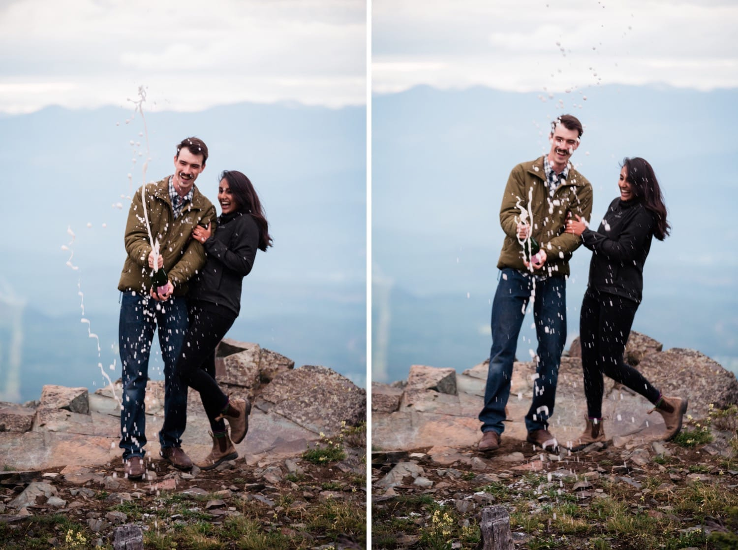 An adventurous couple in hiking gear laughs as they spray champagne from the bottle on top of a mountain outside of Cranbrook, BC