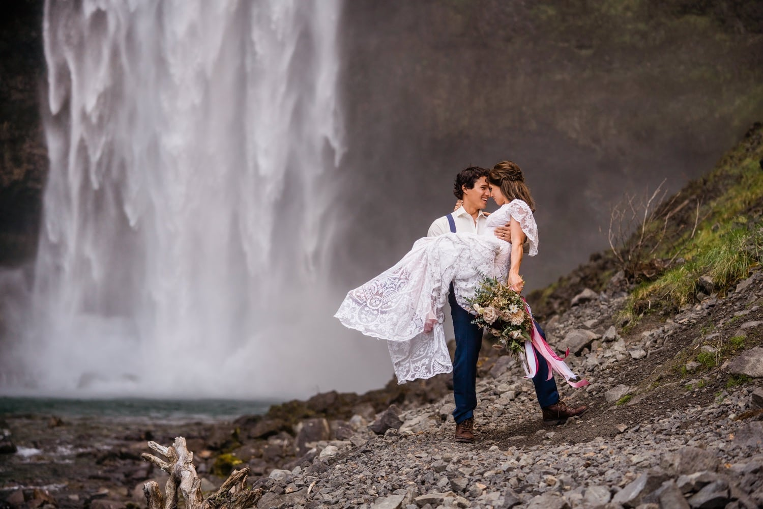 A couple celebrates their Whistler waterfall elopement